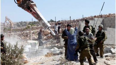 "Photo of Palestinians: ""Israel"" demolishes our homes, but it will not destroy our determination"