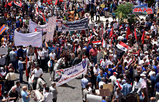 Photo of PHOTOS: Syrians hold large demonstration against Caesar Act in Homs