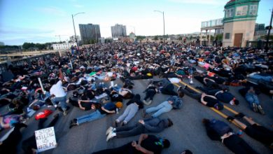 Photo of Protesters in Portland lay on bridge in George Floyd protest